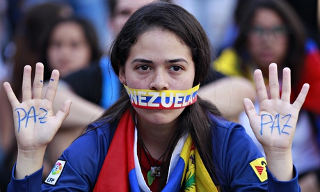 A student takes part in a protest against Nicolas Maduro's government in Caracas, Venezuela.